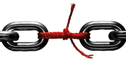 Steel chain held together with red string