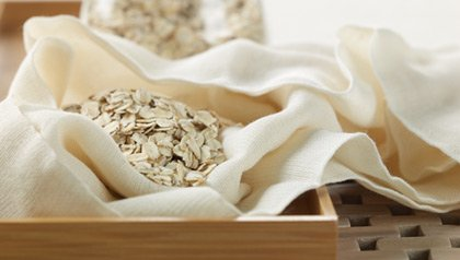 dry oatmeal sits in a lovely linen fabric