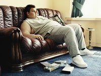 Obese person on sofa- interactive map shows rates for physical inactivity in each state and D.C.