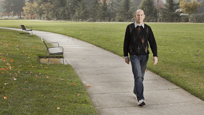 Rick Genter after his 200 pound weight loss, walking in a park.