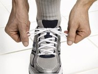 lacing up athletic shoe - New study suggests that middle-aged adults recently diagnosed with diabetes and hypertension may have more time to try to control their high blood pressure without medications.