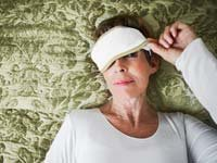 Sleep journal study found that contrary to popular belief sleep quality improves with age- mature woman in sleep mask