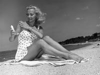 Young Woman; Beach; Sunblock; Suntan; Lotion; Summer; Sand; Face; SPF