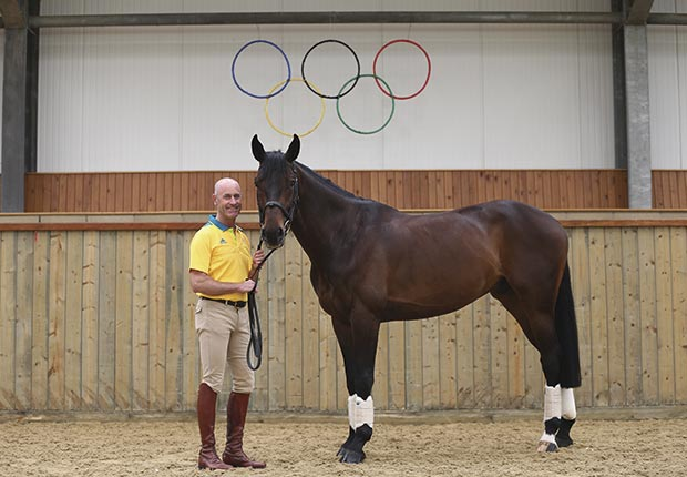 Andrew Hoy poses with his horse Rutherglen before the start of the London Olympic Games where he will compete for Australia in the equestrian events