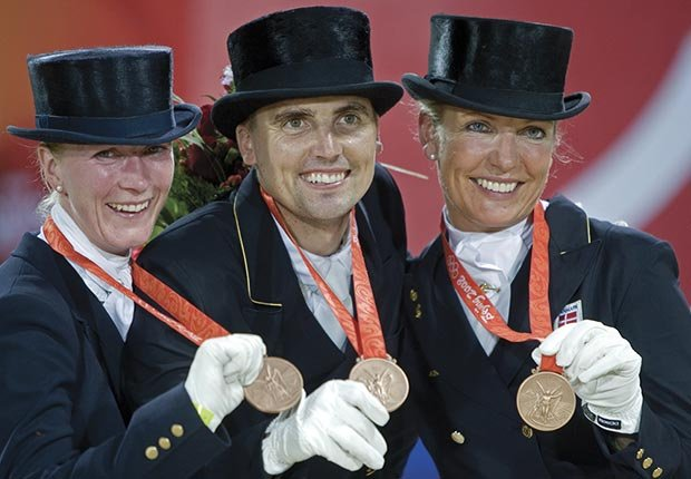Anne van Olst (R) will compete for Denmark in the equestrian events during the London Olympic Games