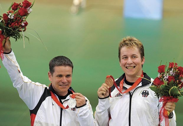 Ralf Schumann (L) won silver in the 25m rapid pistol fire event during the 2008 Olympic Games in Beijing