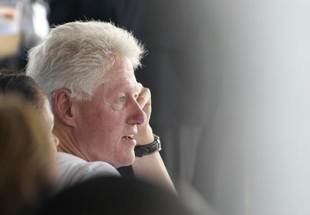 President Bill Clinton listens to Haitian President Michel Martelly