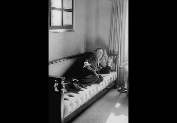 President Lyndon Johnson lies down after lunch