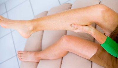 Woman Rubbing Calf Leg Cramp