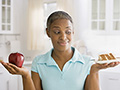Woman holds an apple and cake, Prediabetes health quiz