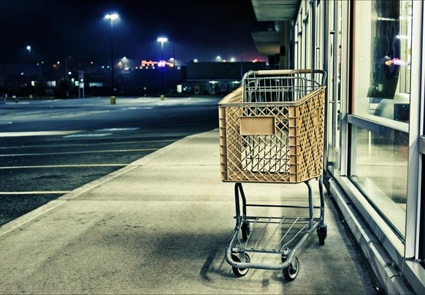 Empty shopping cart on sidewalk, Stop shopping and start saving