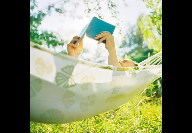 Man reading book in hammock, Trim your TV time