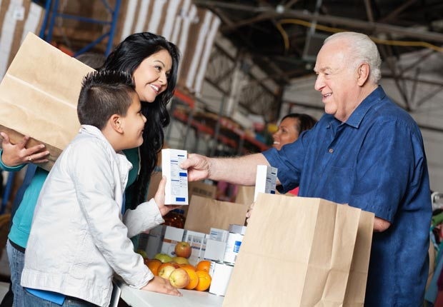 Man volunteering at food pantry, Ignite your passion for compassion