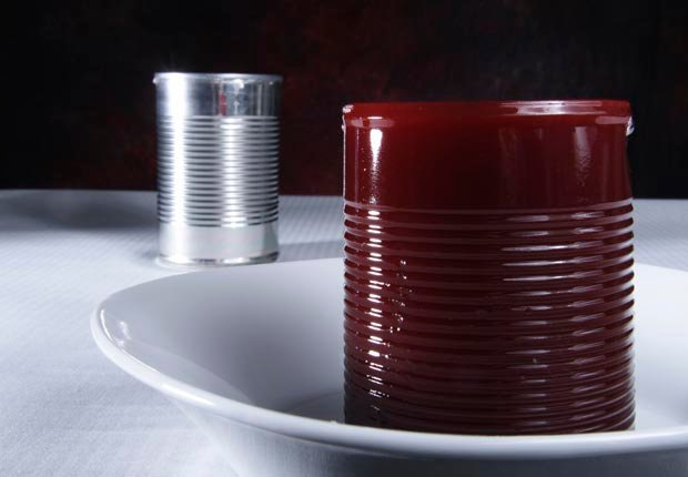 Cranberry sauce on plate with can, Discard old and expired canned food