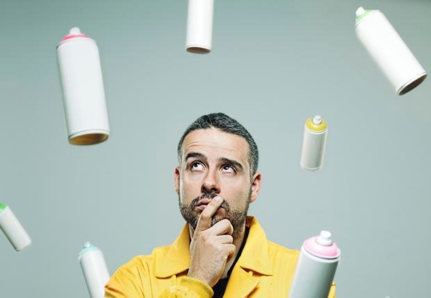 Man watching flying spray cans, Disposal of household items