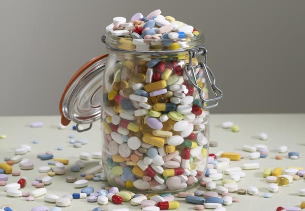 Overflowing jar of pills, Dispose of old medication properly