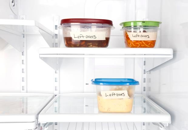 Plastic food containers of leftovers in refrigerator, Disposal of old plastic containers