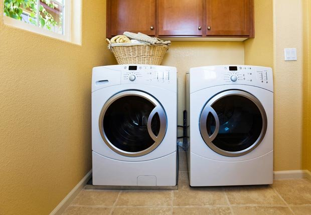 Laundry room appliances. Put clothes in dryer before washing to kill tics. (Getty Images)
