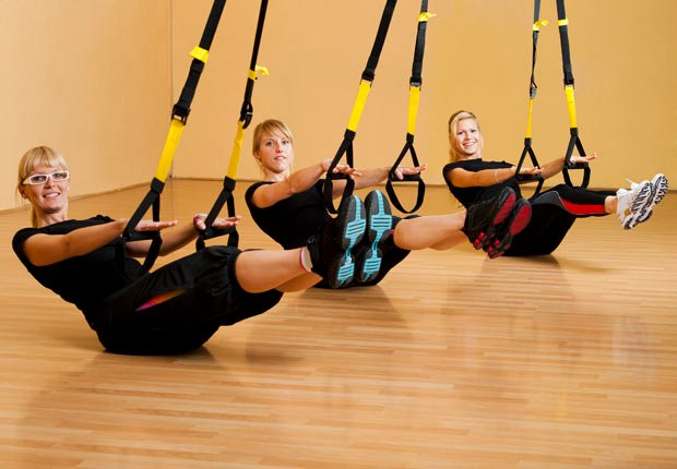 Three women doing suspension training (Getty Images)