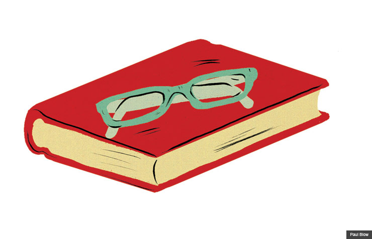Eye glasses on top of a book