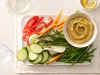 Hummus with raw vegetable batons.