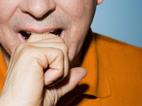 Man biting knuckle, The Fear Project by Angel Livas (Image Source/Corbis)