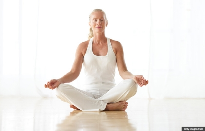 Reduce stress with yoga. (Getty Images/Fotosearch RF)