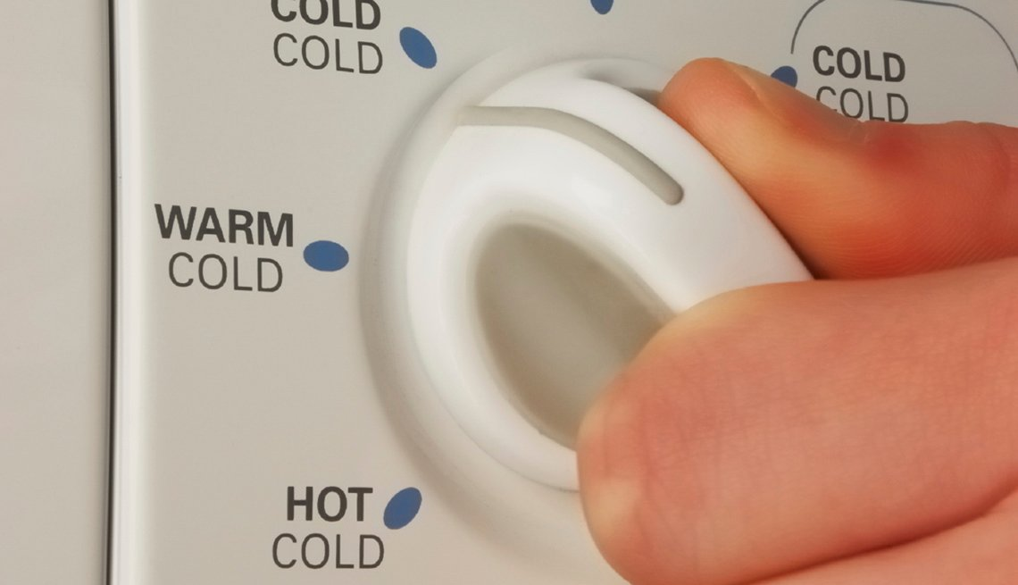 Fingers On Laundry Machine Dial, AARP Health, Think Before You Go Green