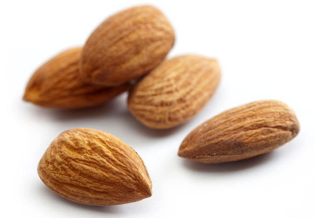 Almonds. These crunchy nuts do more than add flavor to a party snack. Almonds contain magnesium, a muscle-relaxing mineral that plays a key role in regulating sleep. A handful of almonds or a tablespoon of almond butter before bed will help you fall asleep and stay asleep.