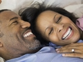 African-American couple in bed, 5 Reasons to Have More Sex After 50