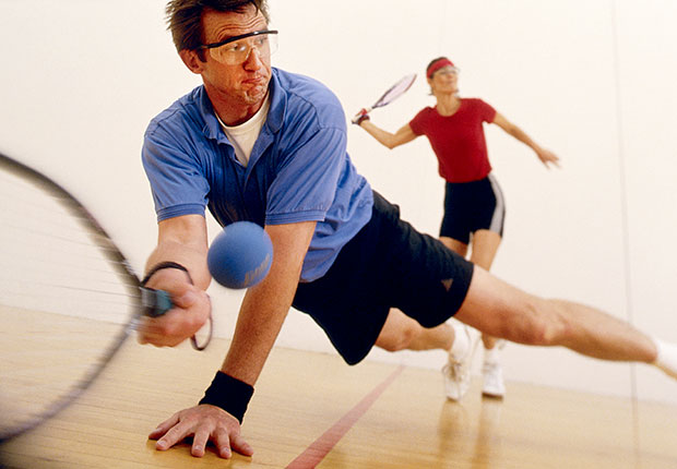 A couple plays racquetball, Faded Boomer Fitness Fads