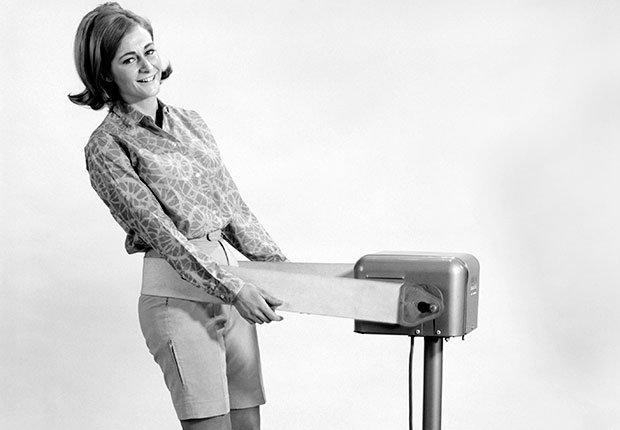 Woman using a vibrating belt machine, Faded Boomer Fitness Fads