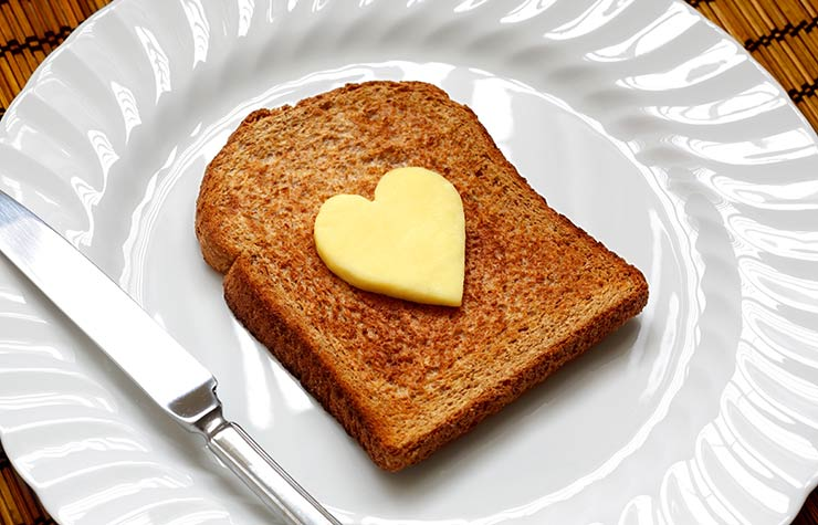 Cholesterol Level Myths Fat Butter Heart Toast Plate Knife