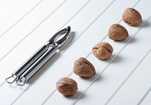 Walnuts with stainless steel cracker, Best Nuts Health