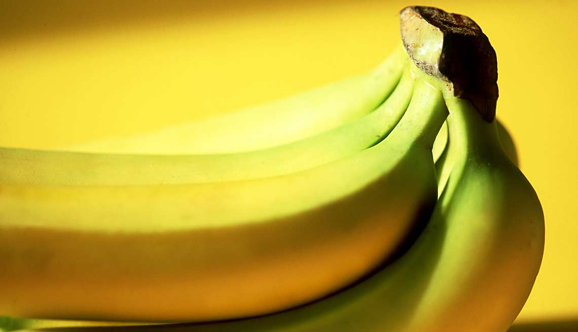 A bunch of bananas on a yellow background, Foods That Help Your Gut