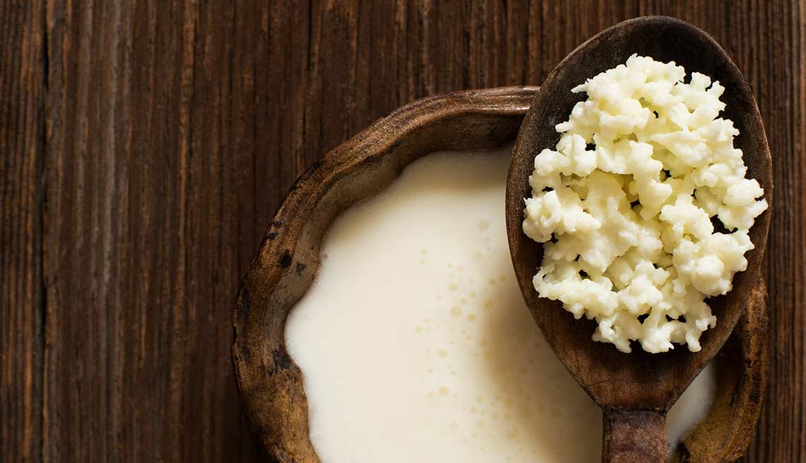 Kefir on a wooden spoon, Foods That Help Your Gut