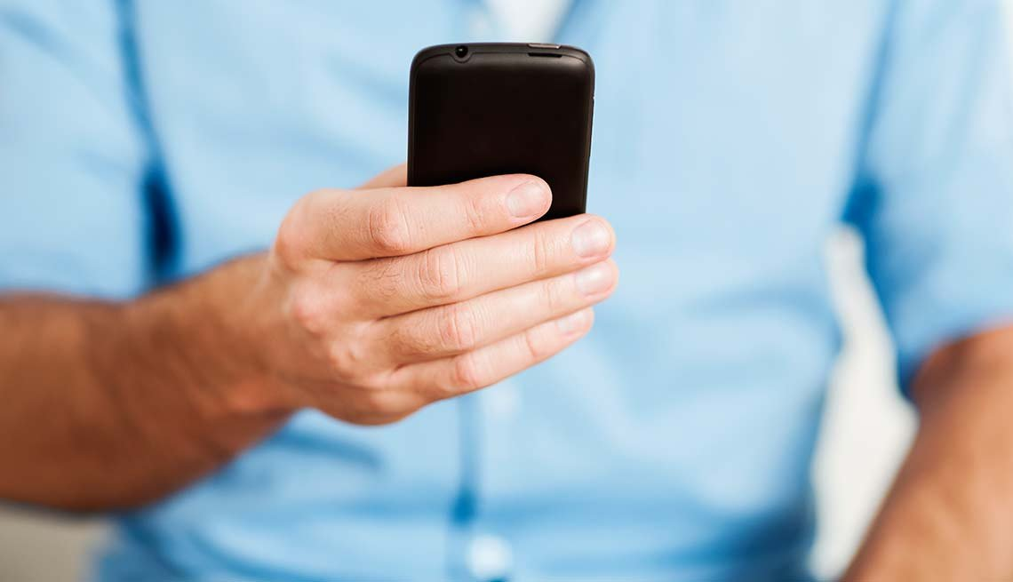 Man with a smart phone. Smartphone Health Apps Can Save Your Life