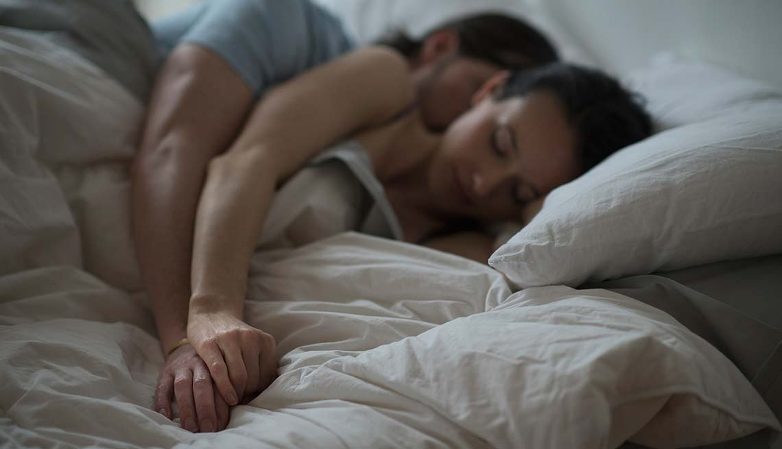 Couple asleep in bed, Smartphone Health Apps Can Save Your Life