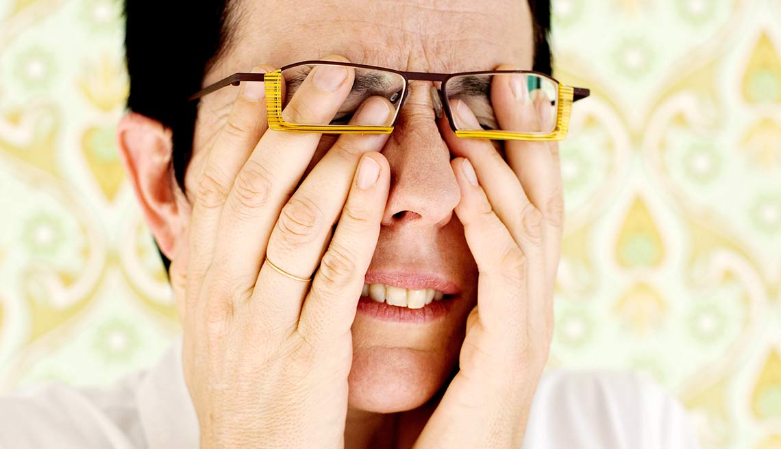 Woman with glasses rubs her eyes, Heart Attack triggers