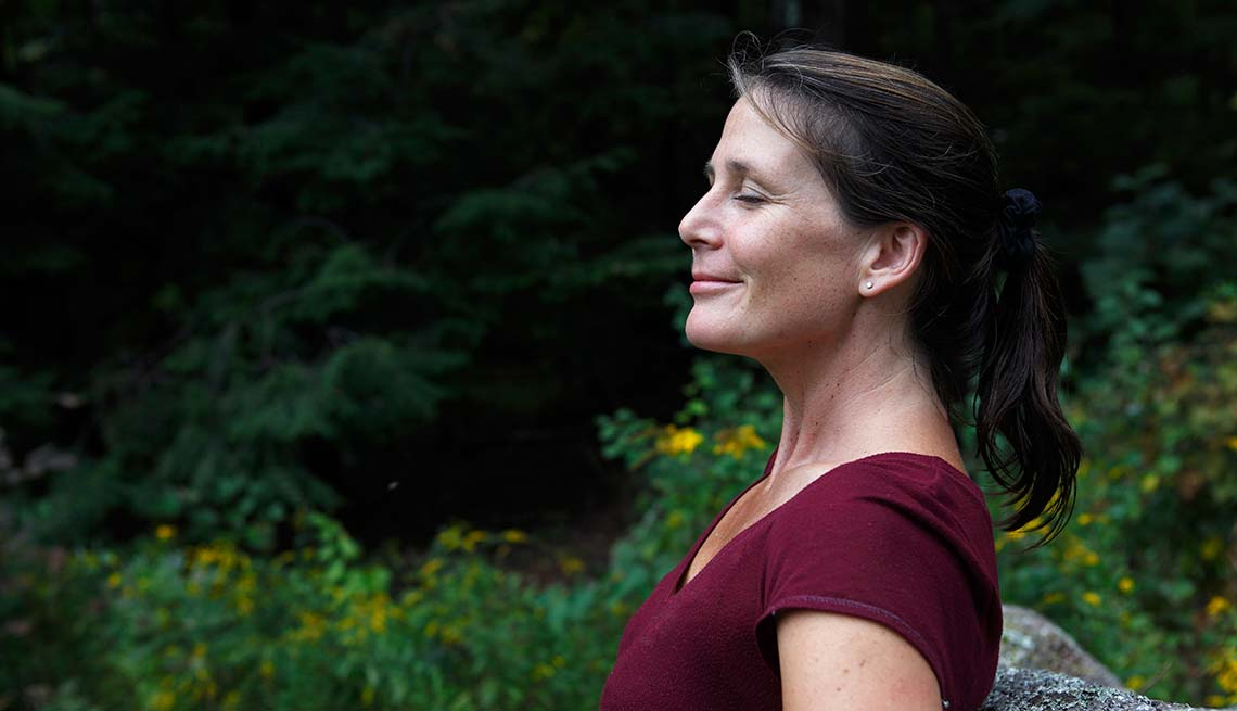 Woman relaxes in fresh air outdoors, Cheap Creative Workout, Home Exercise