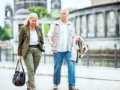 Man and woman walk and talk a long a European street, 6 Ways to Stay Healthy on Vacation