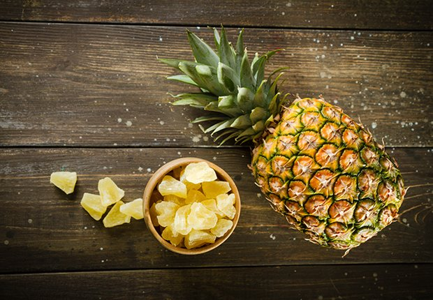 Fresh and Dried Pineapple On Old Wood Table
