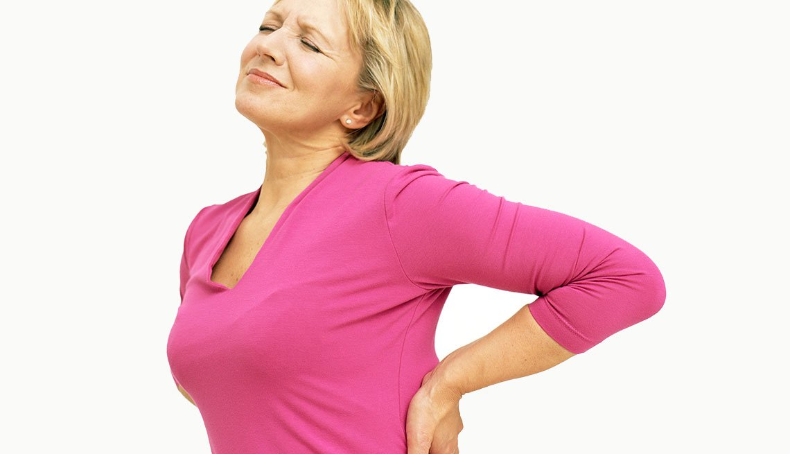 Woman holding her lower back in pain