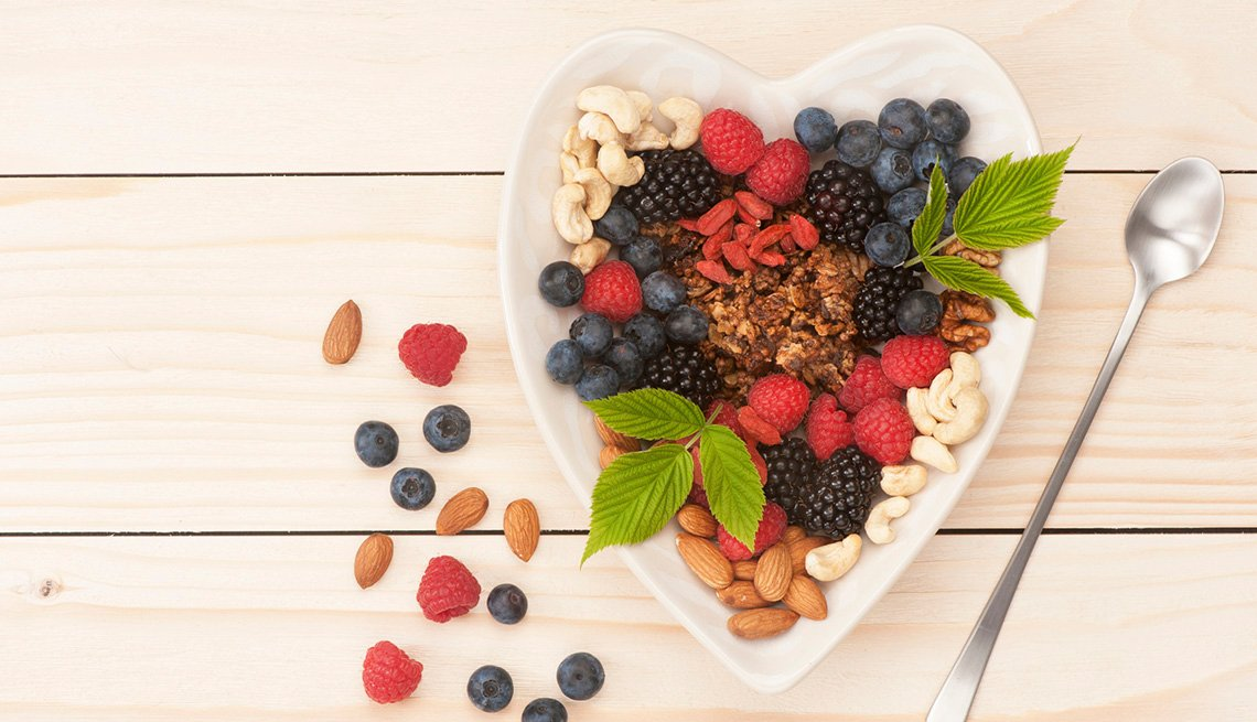 Heart Shaped Bowel Filled With Granola, Nuts And Fresh Fruit, AARP Healthy Living, Fruit Salad Recipes