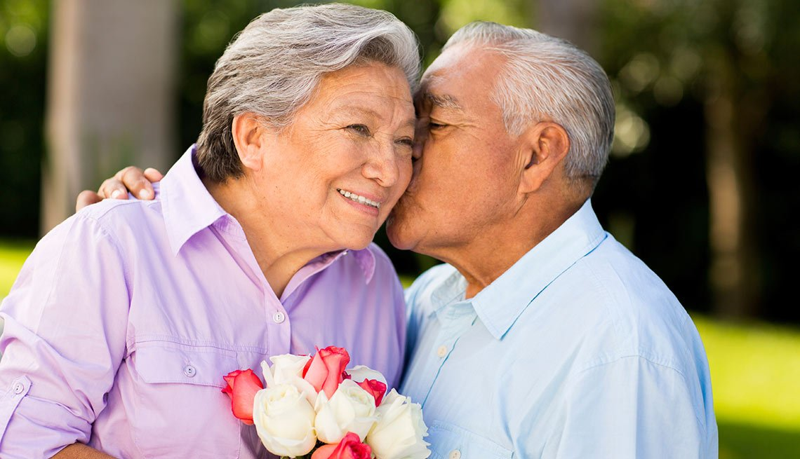 Senior couple kissing in park