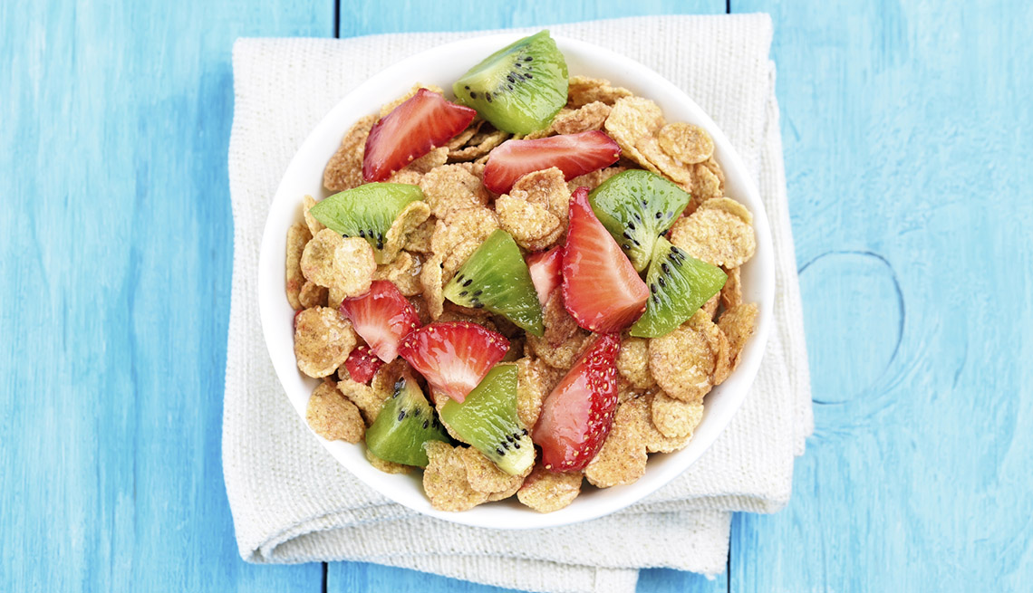 item 2 of Gallery image - Cornflakes Cereal With Strawberry And Kiwi With Bright Blue Background, AARP Healthy Living, Fruit Salad Recipes