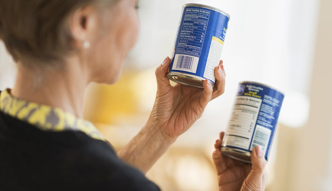 Woman looks at canned soups, Things to Throw Out
