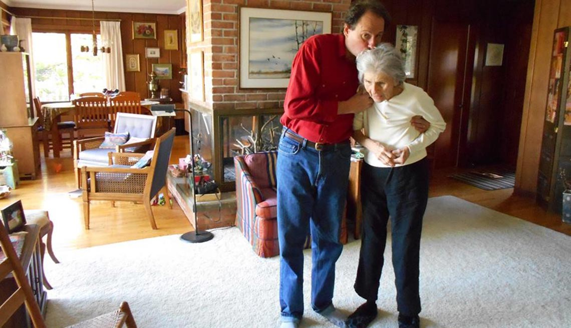 Jeff Yeager and mother in her home