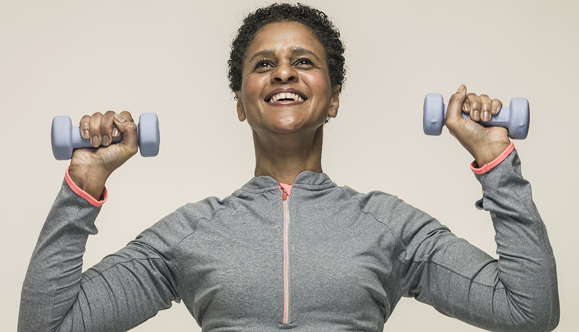 Woman lifts weights,  Jump-Start Your Fitness