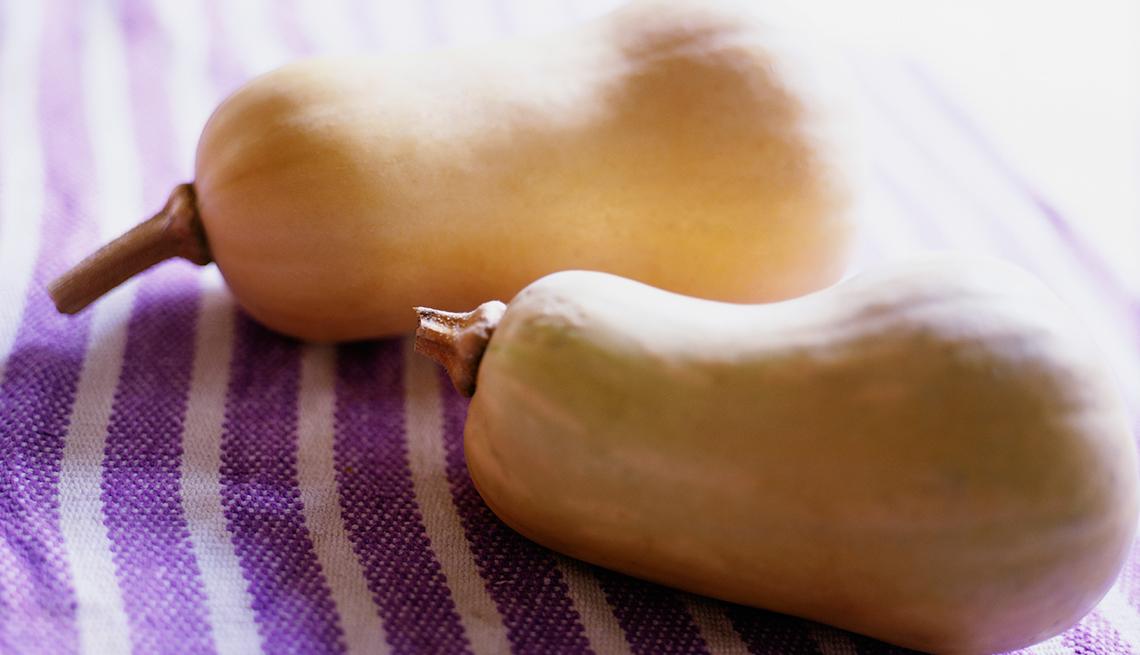 Butternut squash on a purple cloth, Fat Busting Fall Foods